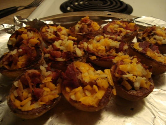 Potato skins stuffed with yummy cheese and bacon. Mmmm
