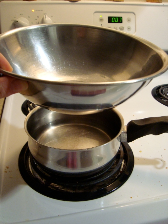 Makeshift double boiler. A metal Bowl on top of a pot with a small amount of boiling water.
