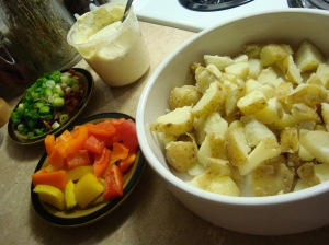 Cooked potatoes, bacon, onions and veggies ready to be mixed