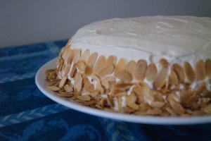 Healthy Carrot Cake with Delicious Cream Cheese frosting and toasted almonds