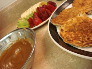 Healthy Homemade Banana Pancakes with fresh fruit and peanut butter syrup!